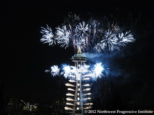 Fireworks go off at the Space Needle for New Year's