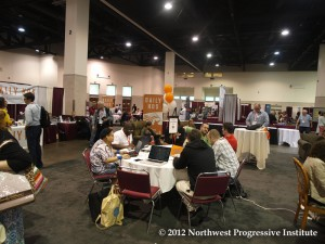 Attendees gather in the Exhibition Hall to visit booths and talk to other convention-goers.