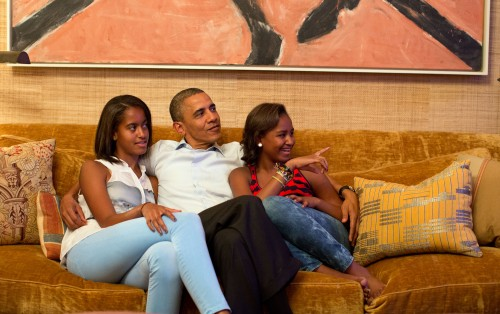 President Obama watches First Lady Michelle Obama's speech with their daughters