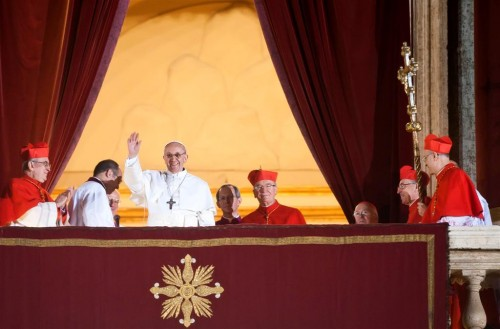 The new Pope, Francis I, waves from a balcony to crowds assembled in St. Peter's Square. (Photo: Vatican News Service)