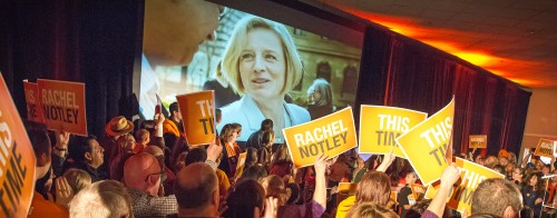 NDP supporters cheer at a campaign rally