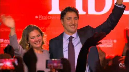 Victorious Trudeau waves
