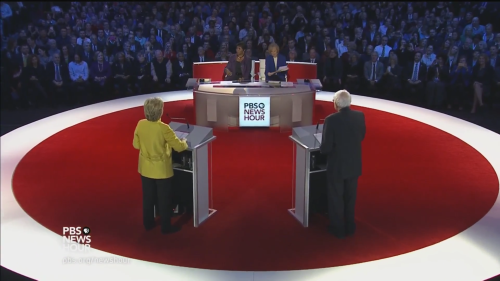 Clinton and Sanders at the sixth Democratic debate