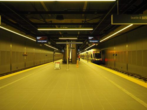 A Link light rail train departs UW Station