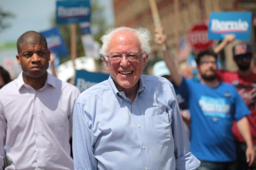 Bernie Sanders walking in a parade