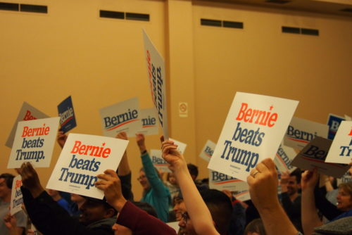 Bernie signs at a campaign rally