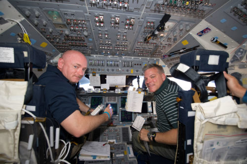 Mark Kelly (left) has flown multiple missions in the Space Shuttle