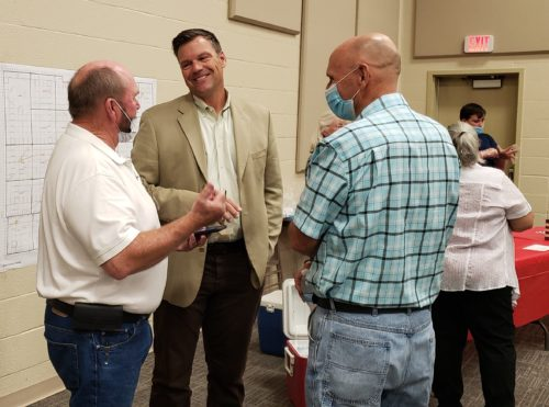 Kris Kobach speaks to voters at a recent campaign event – without a mask, of course