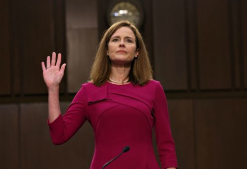 Amy Coney Barrett taking an oath duwing a Senate hearing