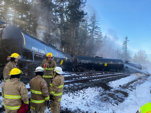 Department of Ecology employees at the site of an oil train derailment