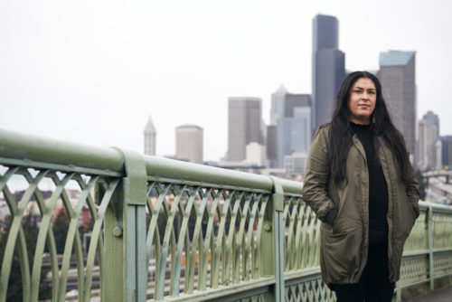 Colleen Echohawk in front of the Seattle skyline