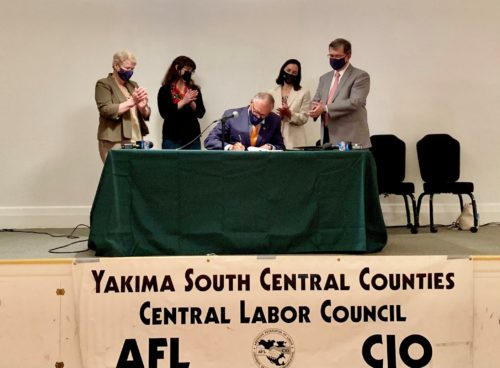 Governor Inslee signs a worker protection bill