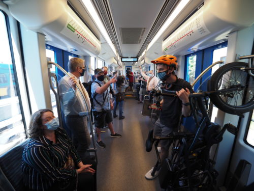 Passengers on the first revenue service trip of a Siemens S700